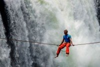 Young man moves across Victoria falls using r