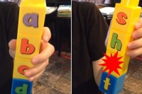 Alphabet building blocks spell out a rude wor