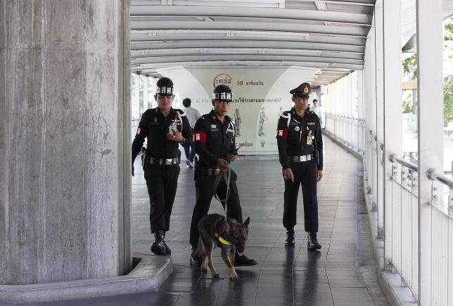 Thai military personnel work with a detection dog on the Bangkok Skywalk